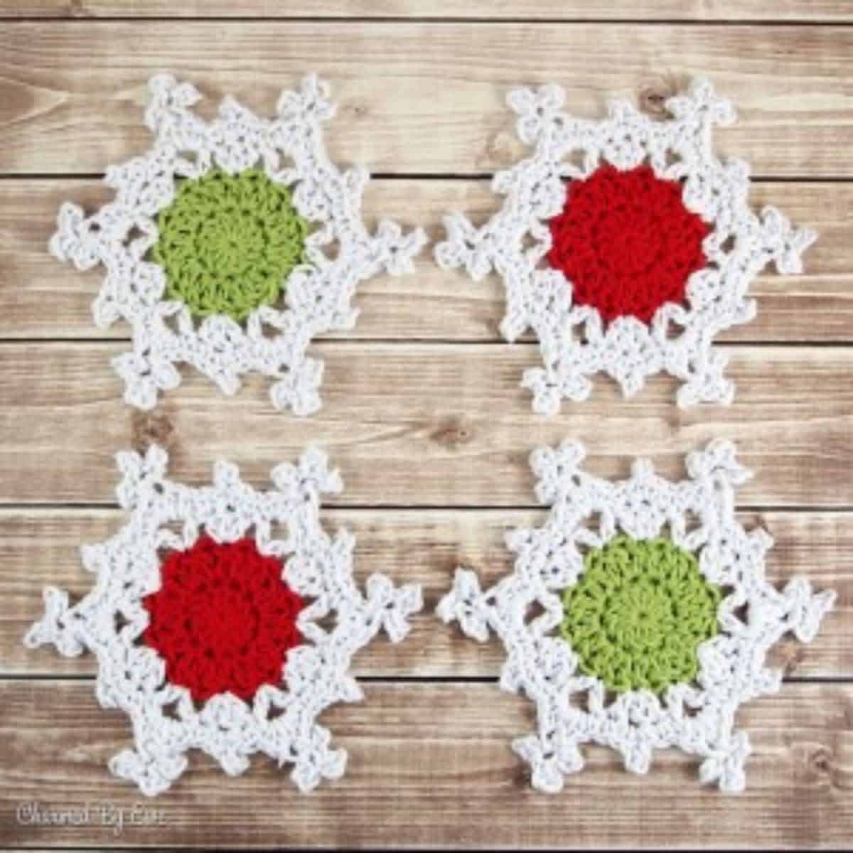 crochet snowflake coasters that have differently colored centers