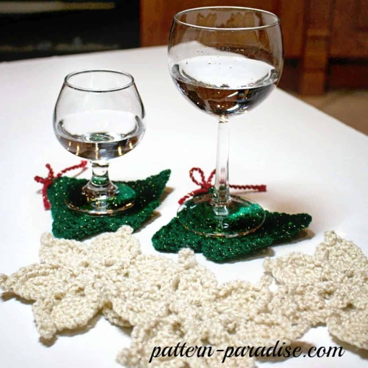 tree and snowflake crochet coasters with wine glasses