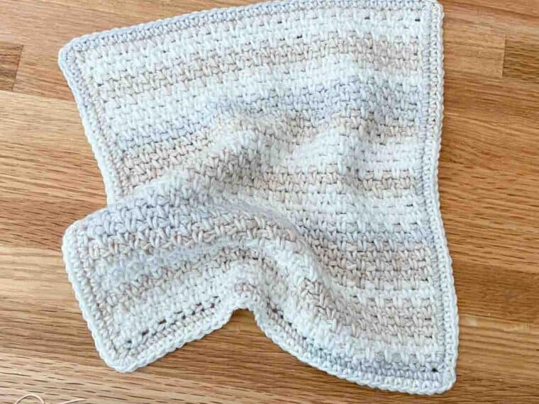 rumpled moss stitch crochet dishcloth laying on a counter