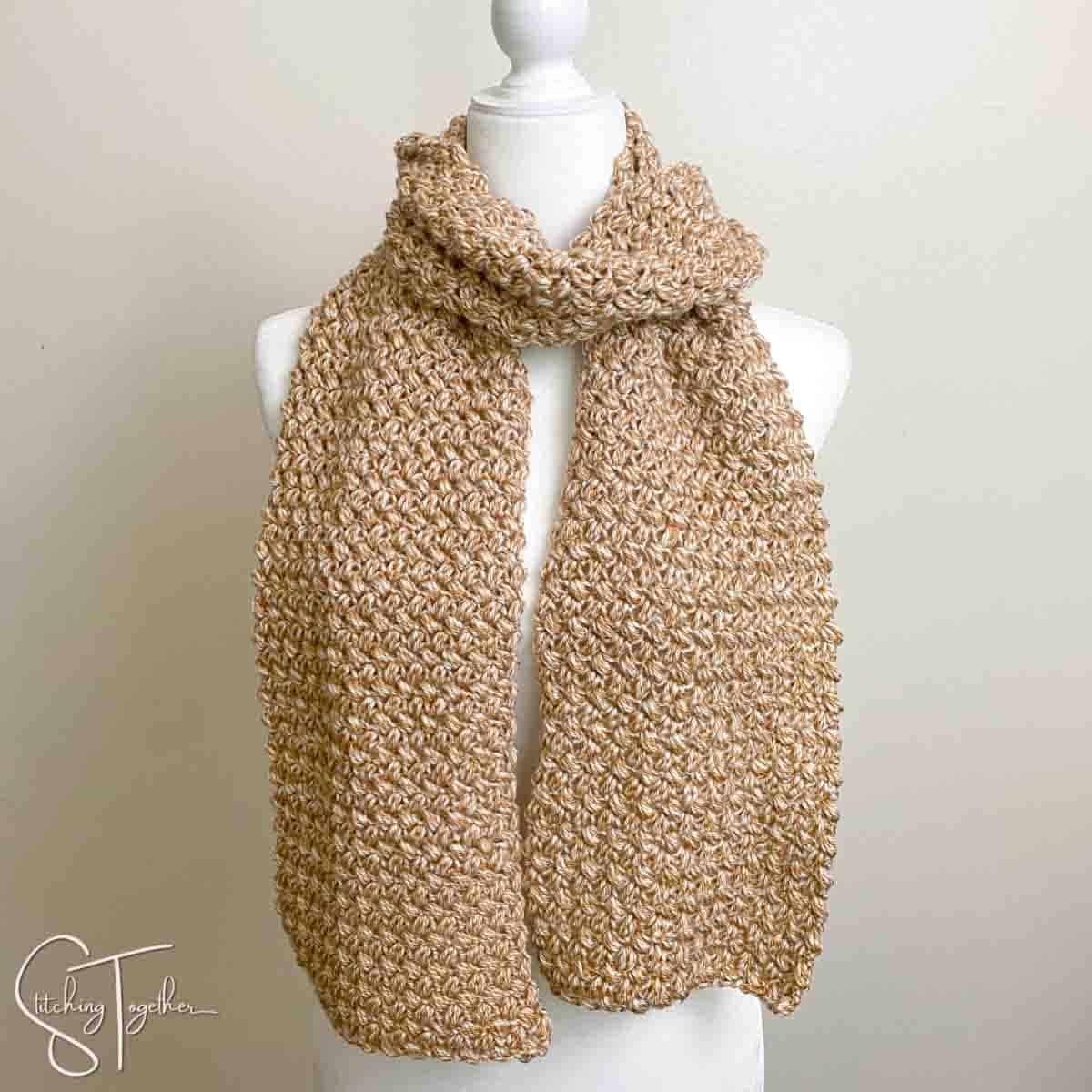 bean stitch crochet scarf wrapped around mannequin