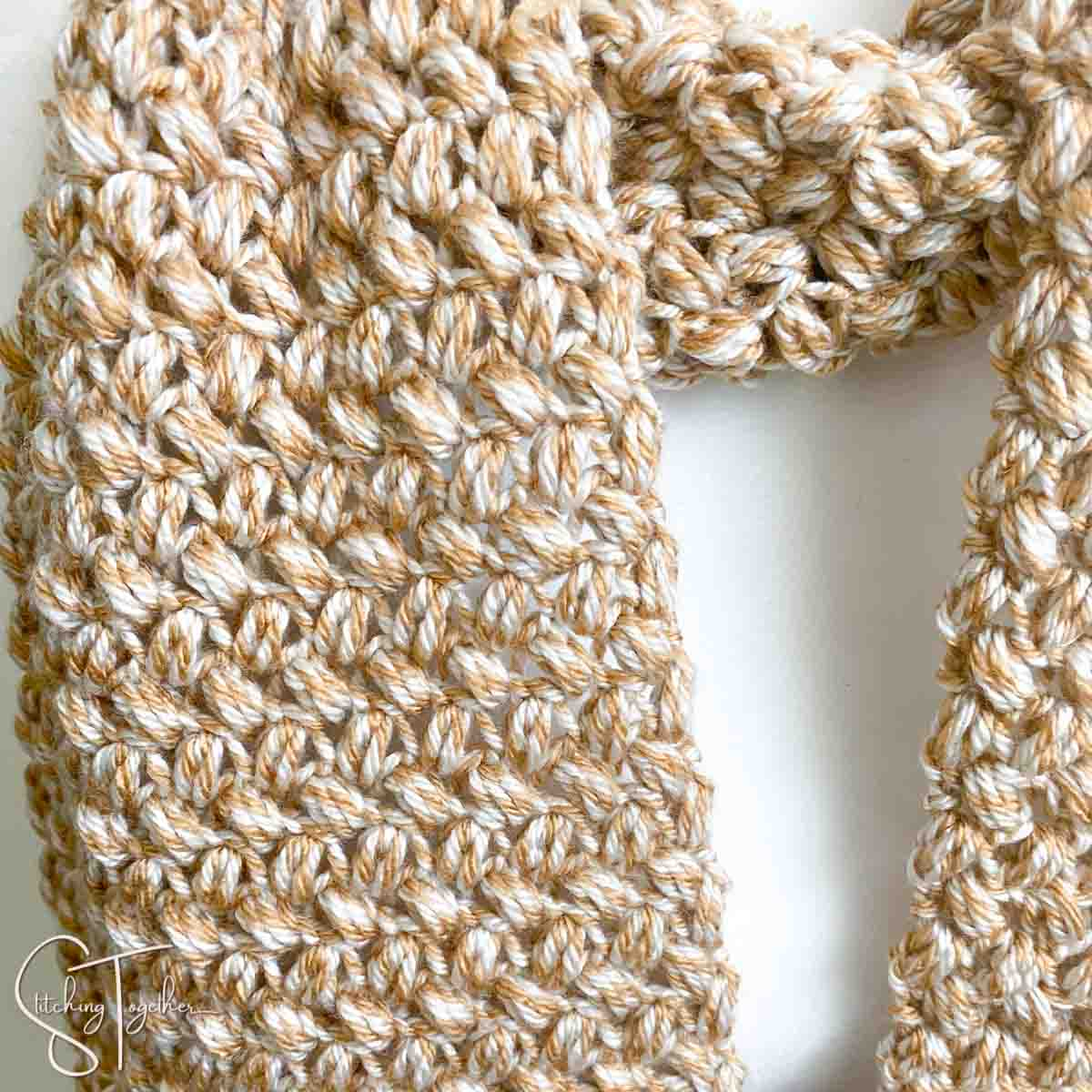 closeup of the crochet bean stitch worked in marled yarn