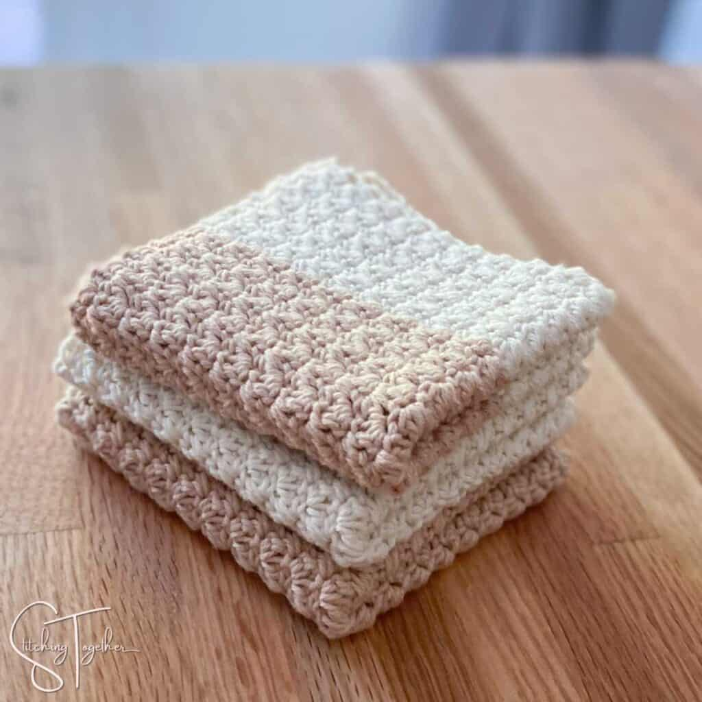 3 crochet dishcloths folded on a counter