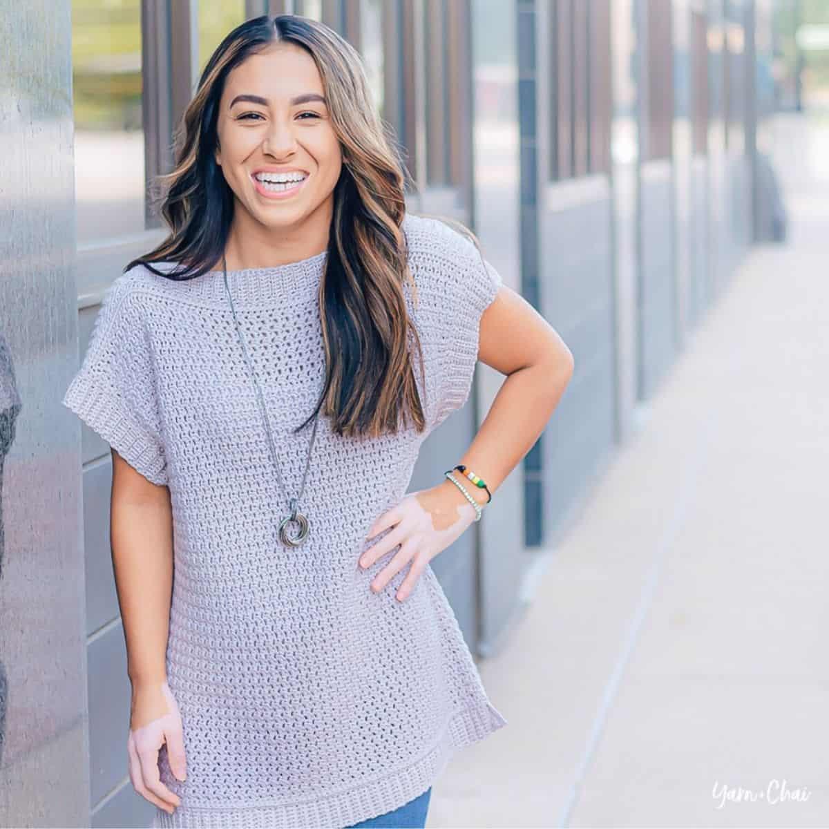 woman wearing a gray crochet top