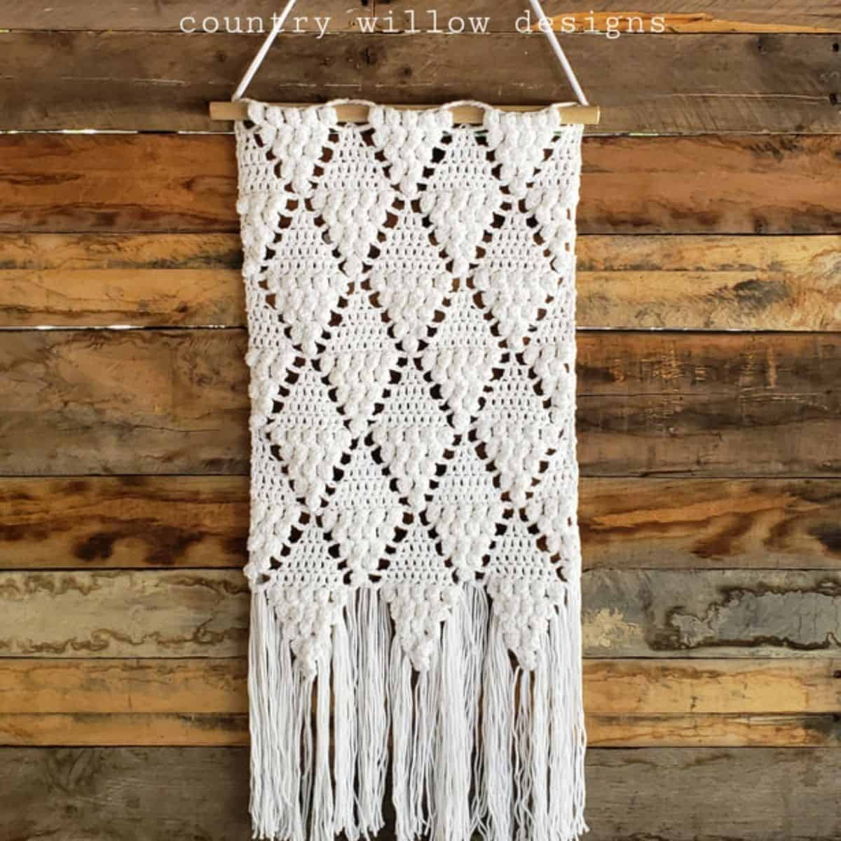 off white crochet wall hanging with diamond pattern
