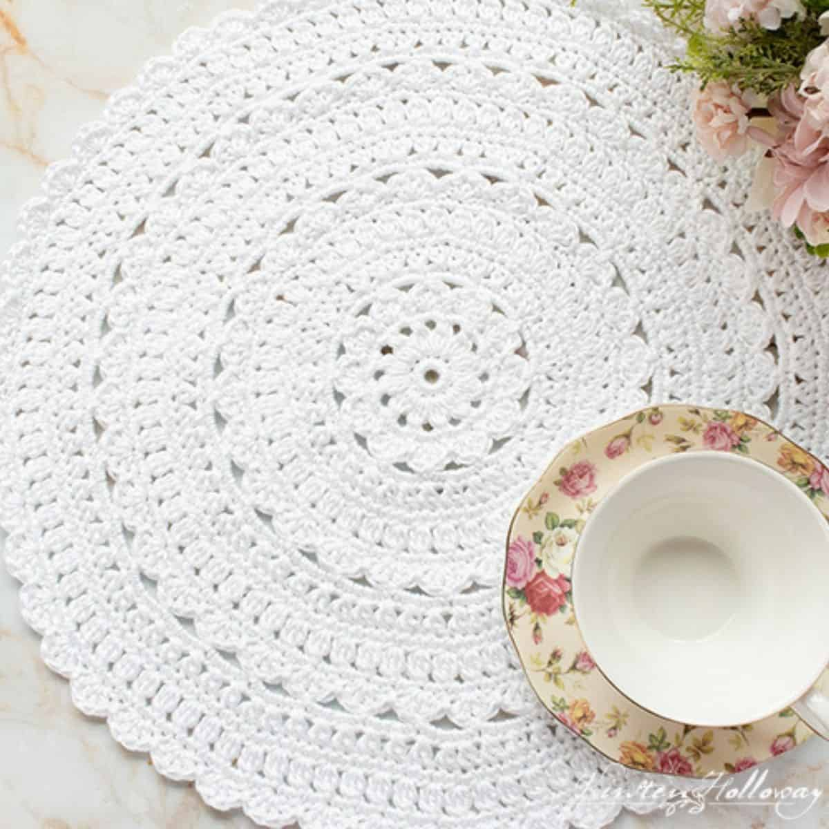 gorgeous white placemat with tea cup sitting on top